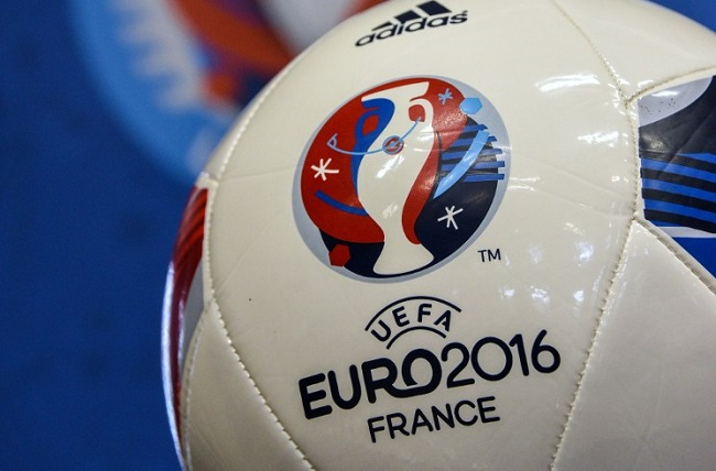 A football marked with the logo of the UEFA EURO 2016 is pictured in the city hall of Lens, northern France, as part of celebrations in the ten host cities of the EURO 2016 on June 11, 2015, as France marks one year to go until Europe's football event. AFP PHOTO / DENIS CHARLET